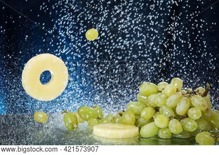 Green Grape Closeup Under The Water Drops In A Dark Blue Background. Healthy Lifestyle. Multivitamin