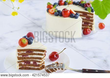 Top View On Homemade Vanilla Birthday Cake Decorated With Berries: Strawberries, Blueberries, Cherri