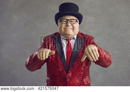 Funny Chubby Rich Senior Man In Shiny Jacket And Black Top Hat Dancing And Smiling