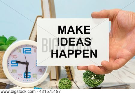 Make Ideas Happen - Text On A Card In Your Hand Next To Office Supplies