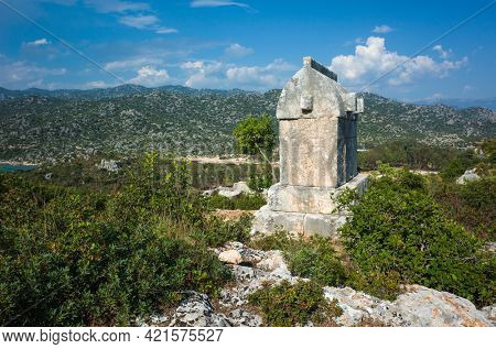 Lycian rock tomb sarcophagus at ancient Lycian necropolis in Simena (Kalekoy), Turkey Mediterranian region