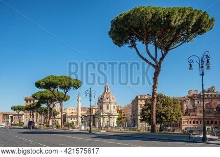 Empty street with view at Trajan's column and Santa Maria di Loreto church in Rome, Italy