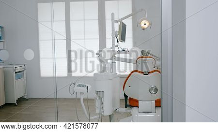 Empty Dental Orthodontic Chair In Dentistry Stomatology Hospital Room With Nobody In It. Modern Orth