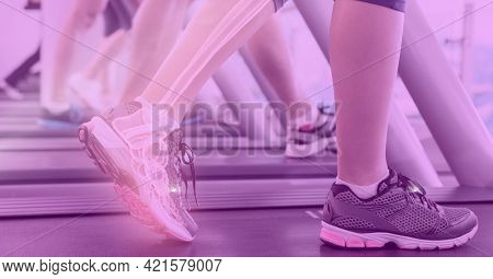 Composition of woman's legs exercising on treadmill with visible x ray bones and pink tint. technology, sport, fitness and active lifestyle concept digitally generated image.