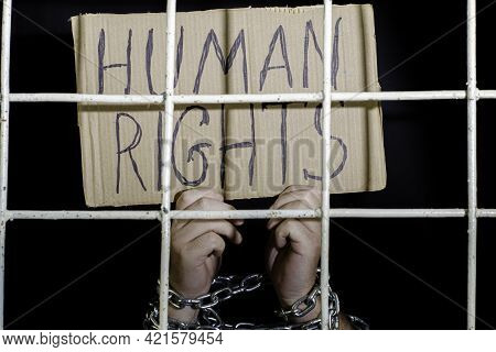 Concept Human Rights Freedom Of Speech Hands Shackled With An Iron Chain Hold A Cardboard Sign With