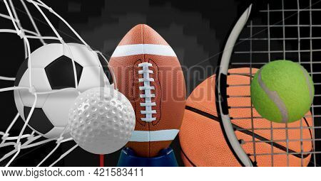 Composition of multiple sport equipment and balls on black background. sport, fitness and active lifestyle concept digitally generated image.