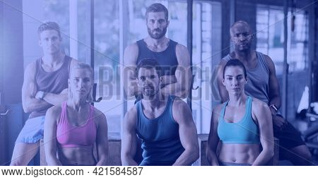Composition of group of fit people at gym over light blur. sport, fitness and active lifestyle concept digitally generated image.