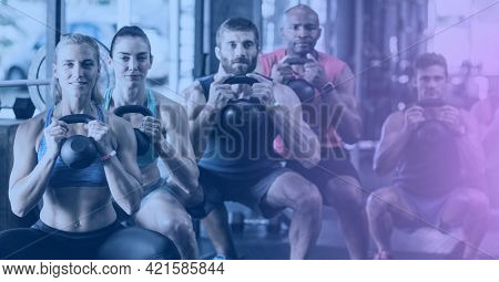 Composition of group of fit people exercising with dumbbells over light blur. sport, fitness and active lifestyle concept digitally generated image.