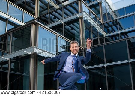 Business Excitement. Funny Businessman Jumping For Joy Celebrating A Successful.