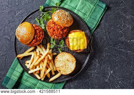 Homemade Bbq Sloppy Joe Sandwiches With French Fries On A Black Plate, Flat Lay, Free Space