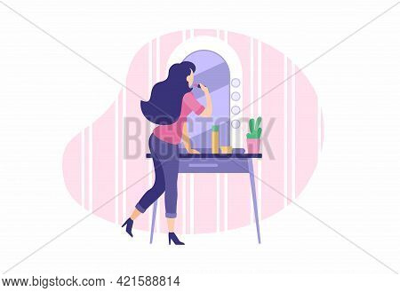 Stylish Girl Does Makeup Near Mirror. Young Woman Paints Lips And Applies Foundation To Face. Routin