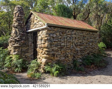 Halfway Hut Along The Telegraph Track Is A Stone Bush Hut Surrounded By Lush Coastal Vegetation - Wi
