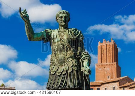 Trajan Emperor Of Ancient Rome Old Statue With Medieval Tower Of Militia In The Background Along Imp