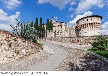 Beautiful View At The Entrance To The Historic Castle Of Brescia On A Sunny Summer Day. Lombardy, It
