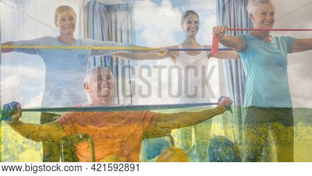 Composition of senior group exercising with instructor and trees in sunlight. healthy active retirement lifestyle concept digitally generated image.