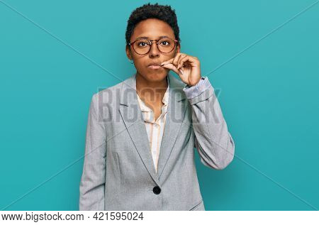 Young african american woman wearing business clothes mouth and lips shut as zip with fingers. secret and silent, taboo talking