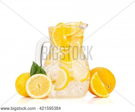 Fresh lemonade glass pitcher with ripe citrus fruits. Isolated on white background
