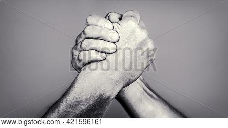 Two Men Arm Wrestling. Arms Wrestling. Friendly Handshake, Friends Greeting. Handshake, Arms, Friend