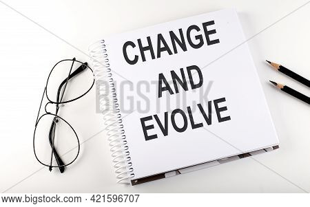 Notebook With Text Change And Evolve On The White Background