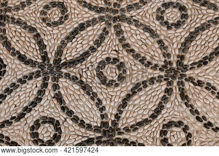 Magnificent Top View Of Pattern Lined With Small White And Black Round Pebbles