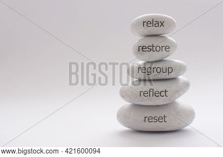 Yoga Zen Stones Balancing On Top Of Each Other With Inspiring Words For Relaxation