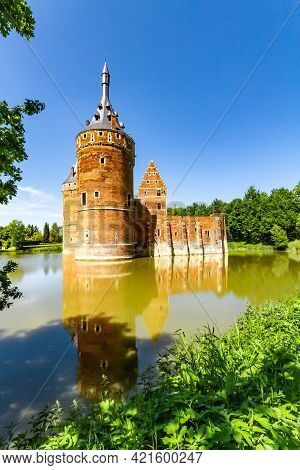 Charming Beersel Castle. The Walls And Towers Of A Medieval Castle. The Castle And The Reflection In