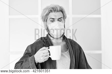 Hospital Or Pollution Protect Face Masking. Medical Mask As Corona Protection. Man Drink Coffee In R