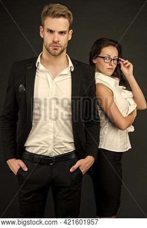 Young And Successful. Professional Couple Dark Background. Businessman And Businesswoman In Formal W