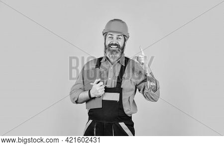 Builder In Hardhat. Apartment Under Repair Portrait. Estimated Property Value Concept. Industry And