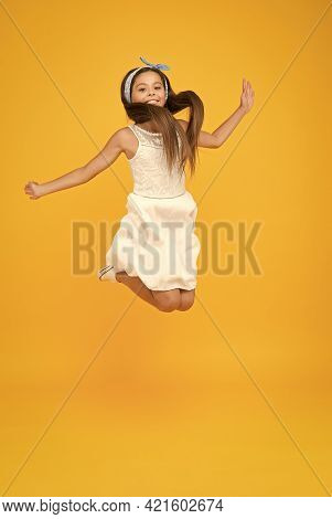 Freedom. Kid Full Of Energy Jumping Enjoy Long Healthy Hair. Cute Hairstyle. Happy Childhood. Carefr
