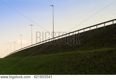 Highway In A Green Field Against A Blue Sky. Road Landscape. Copy Space.