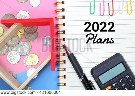 Words Plans 2022 And Wooden Houses. Real Estate Planning And Financing Concept