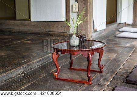 Wooden Korean Tea Table With Traditional Korean House In The Historic Hanok.