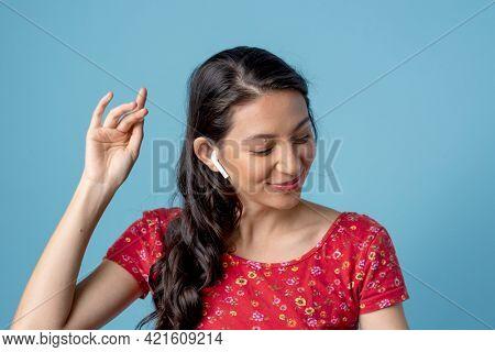 Woman listening to her favorite music through earphones