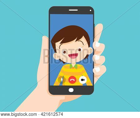 Hand Holding Smartphone With Children Boy On Screen.video Call With Cute Boy Or Student.