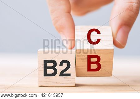Hand Change Wooden Cube Block From B2c To B2b. E Commerce, Marketing And Strategy Concepts