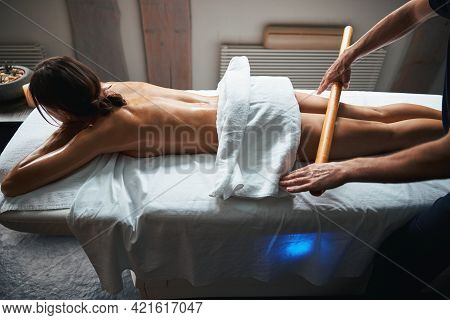 Pretty Caucasian Woman With Towel In Her Body Receiving Anti Cellulite Procedure On Her Legs In Beat
