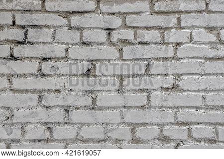 Texture Gray Brick Gray Wall Close-up Background. Brick Gray Background. Uneven Brickwork Old