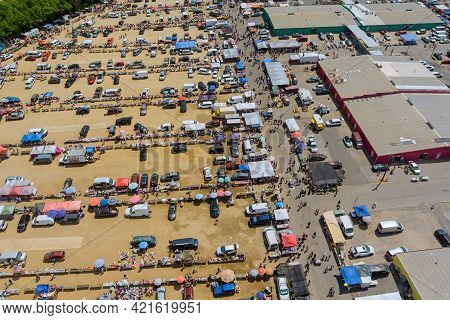 Aerial Panorama View On Flea Market With Miscellaneous Items And Crowds Of Buyers And Sellers In Eng