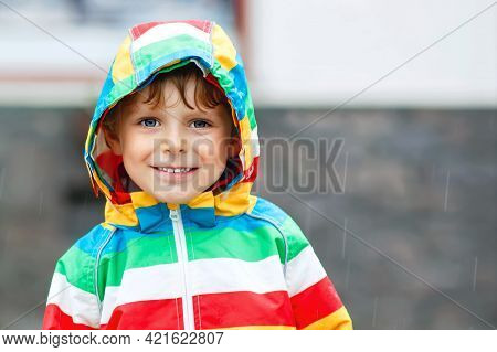 Portrait Of Little Toddler Boy Playing On Rainy Day. Happy Positive Child Having Fun With Catching R