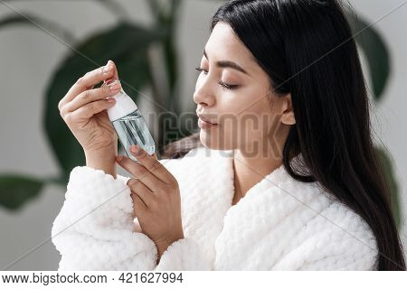 Concept Of Natural Beauty And Skincare Procedure. Side Portrait View Of Young Asian Woman Looking At