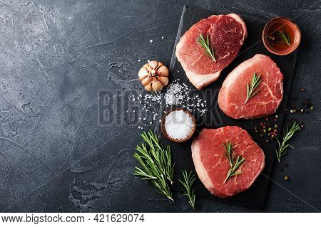 Raw Beef Meat On Slate Black Plate. Top View Flat Lay With Copy Space