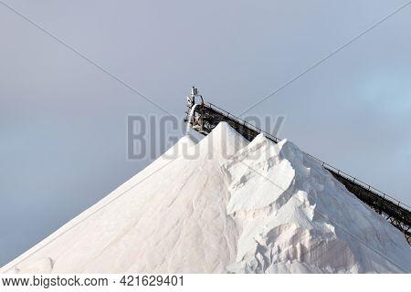 Huge pile of salt against the blue sky