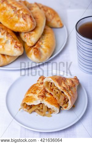 Pies (pirozhki) With Cabbage. Homemade Baking. Traditional Russian And Ukrainian Cuisine. In The Bac