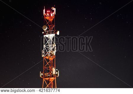 Against The Background Of The Starry Sky, The Mobile Communication Towers Of The 4g And 5g Systems.