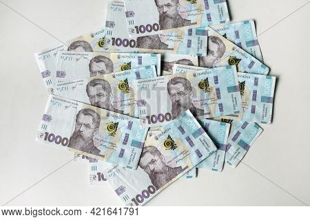Ukrainian Money. Background Of The Thousand Hryvnia Banknotes. Close Up Finance Background.
