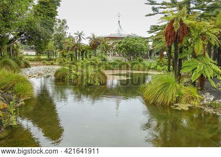Rainy Impression Including The Rotinda At Rotorua In New Zealand