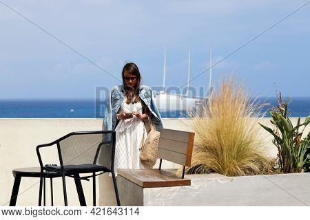 Monte-carlo, Monaco - June 16, 2019: Beautiful Young Brunette Woman With Sunglasses Looking At Her S