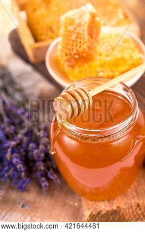 Glass Pot With Floral Honey Isolated On White Background.