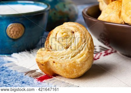 Fresh homemade puff pastry rolls with cinnamon. Selective focus.